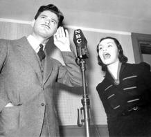 Norman-Corwin-appears-in-the-NBC-radio-studio-with-Peggy-Burt.-